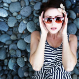 Woman with sunglasses on rocks