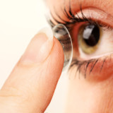 Girl Putting On Contact Lenses