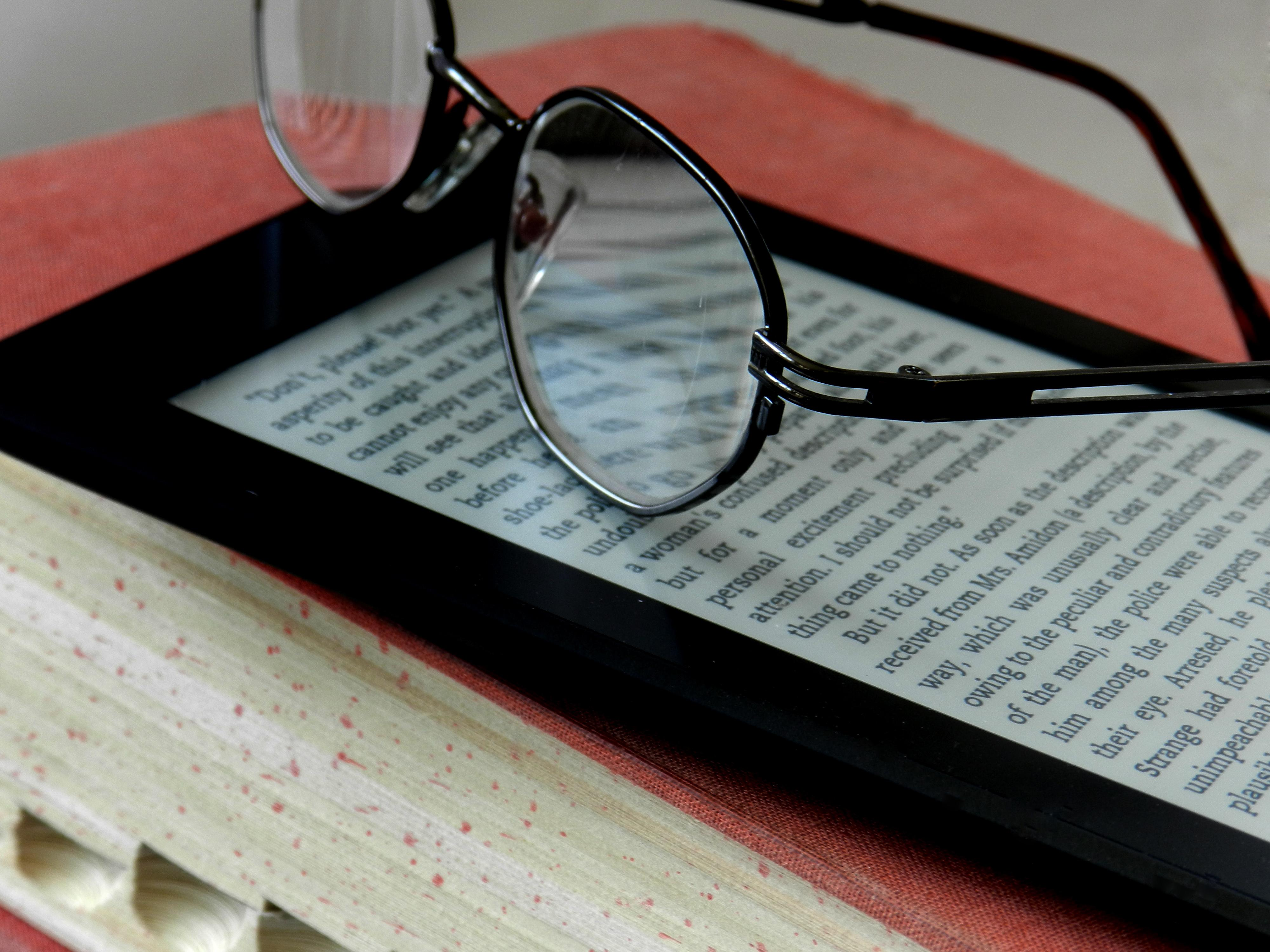 E-reader with glasses on top